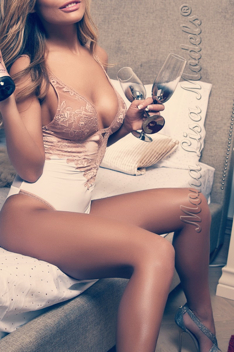 Elite model posing for Newcastle escorts holding champagne glasses