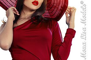 Model in red holding her hat