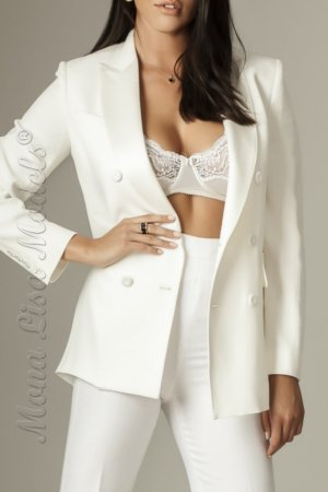 Martina posing in a white suit